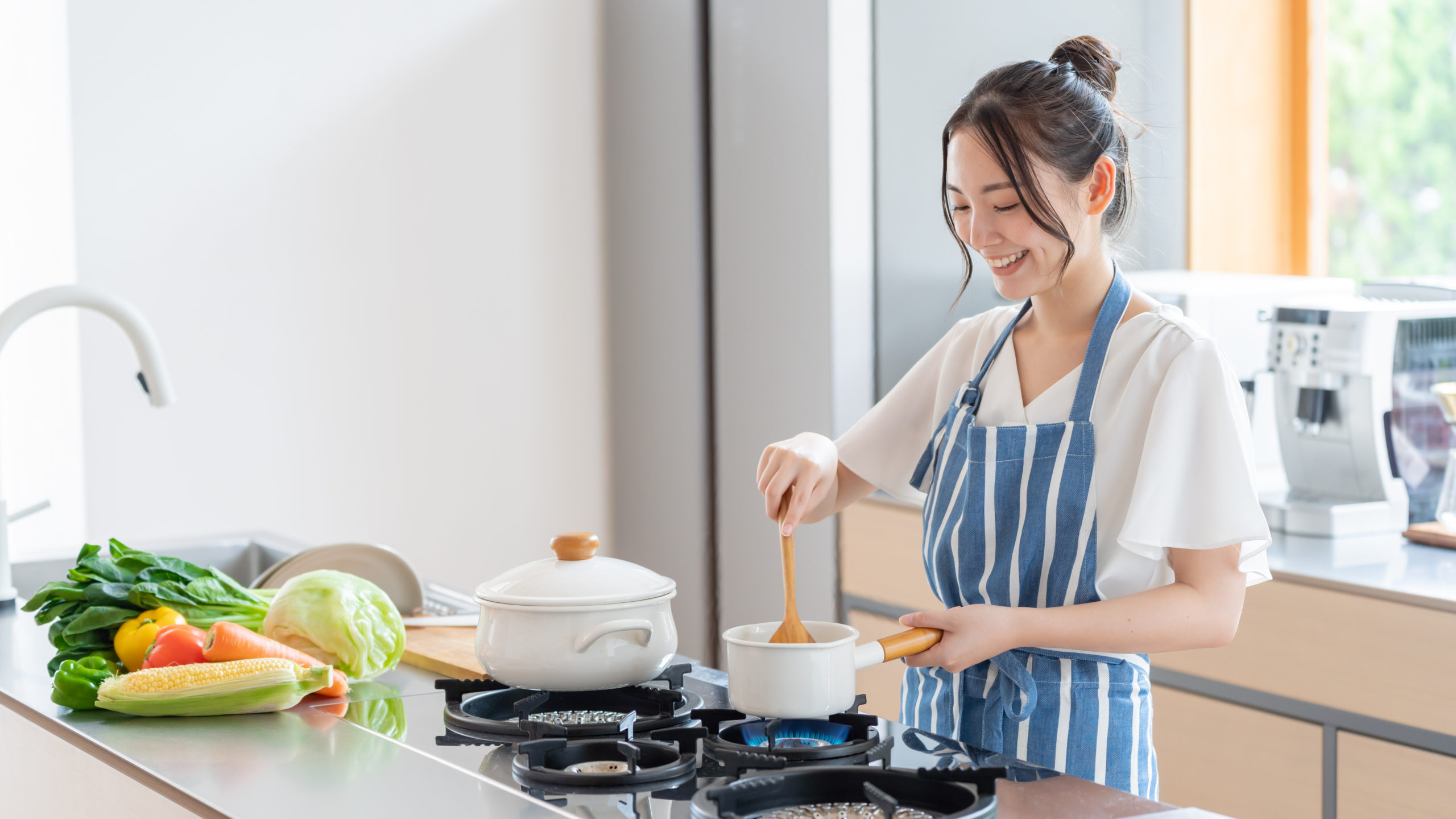attractive-asian-woman-cooking-kitchen-1813462303