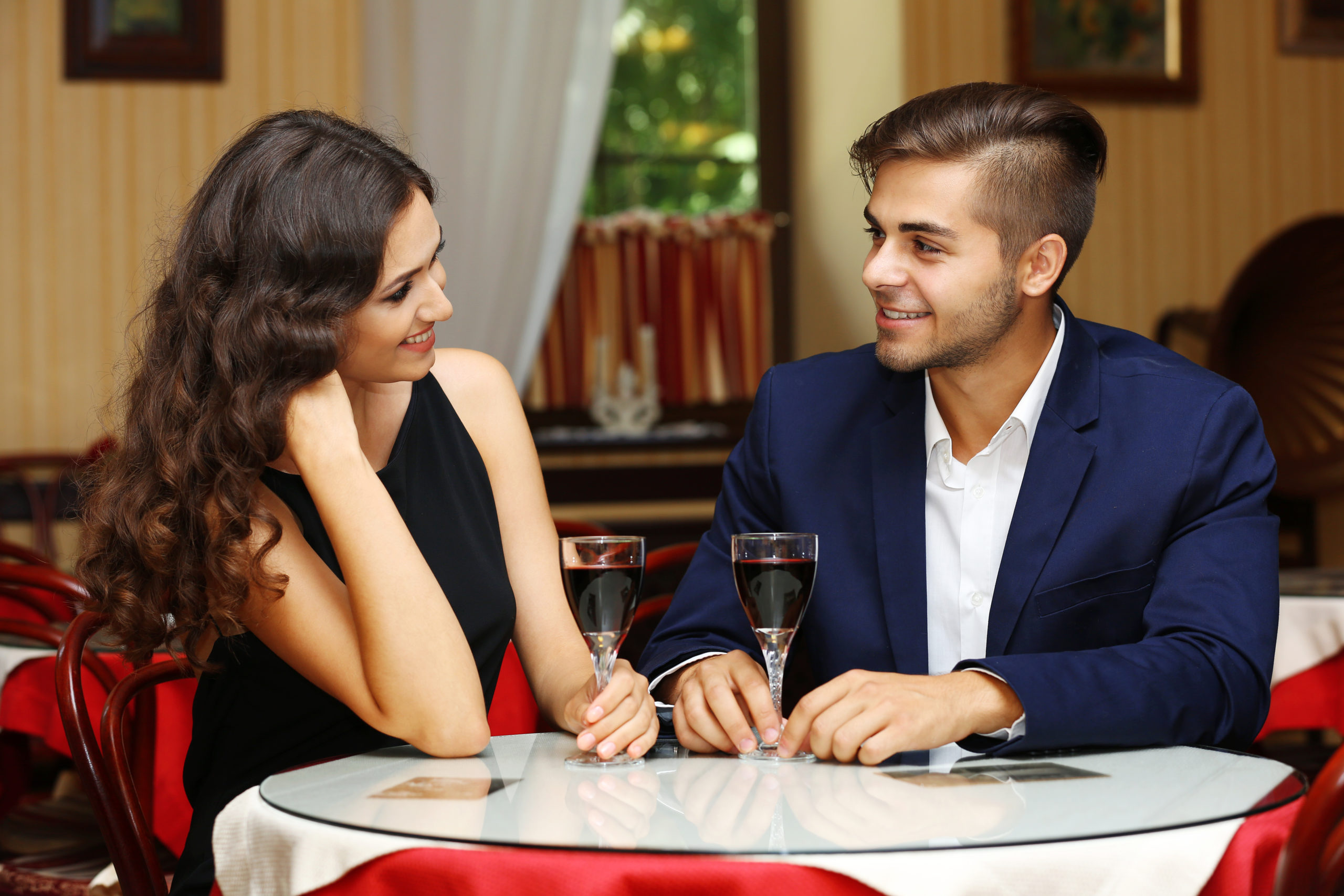 attractive-young-couple-dating-restaurant-329814443