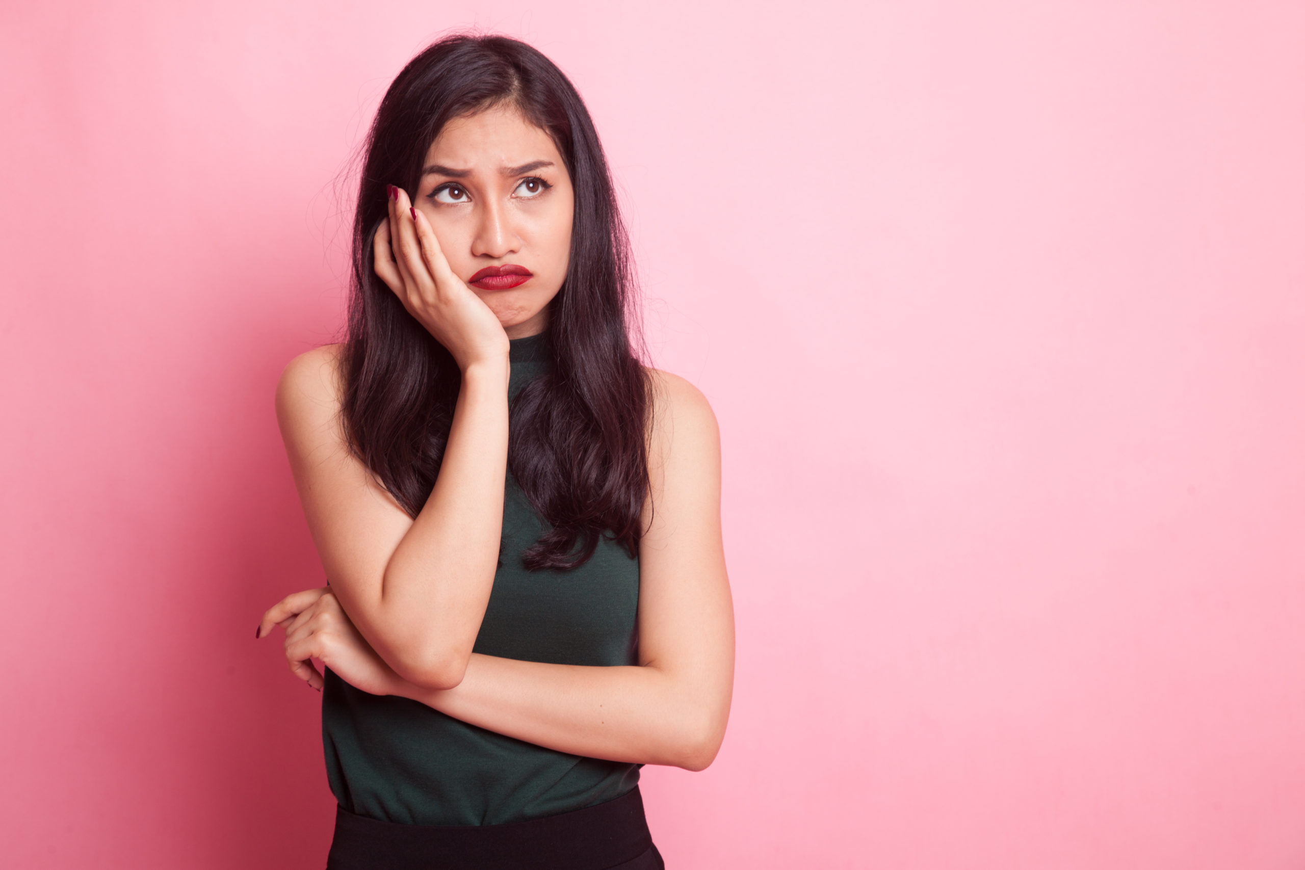Beautiful,Young,Asian,Woman,Get,Bored,On,Pink,Background