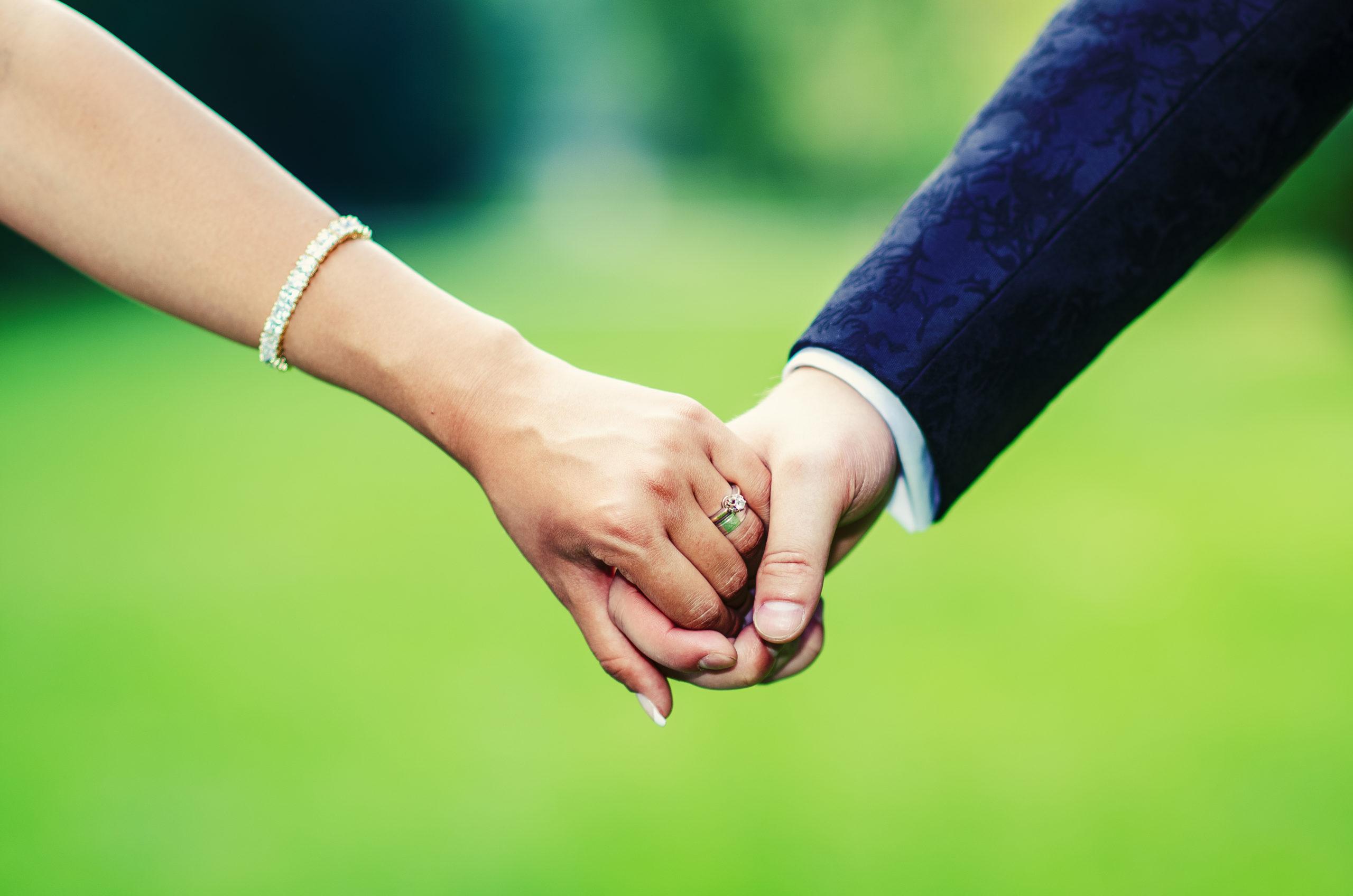 bride-groom-holding-hands-186336611