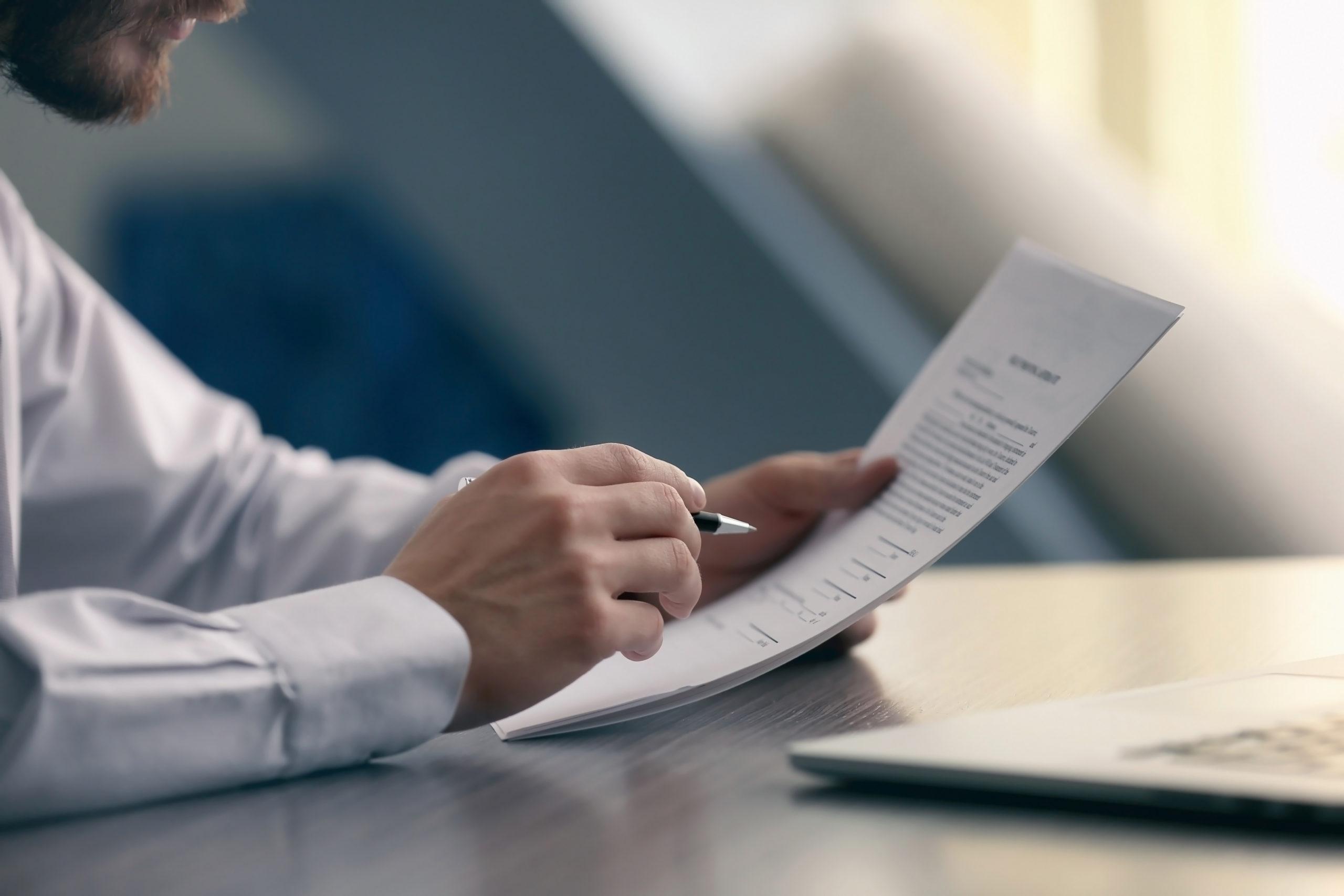 businessman-reading-documents-543880450