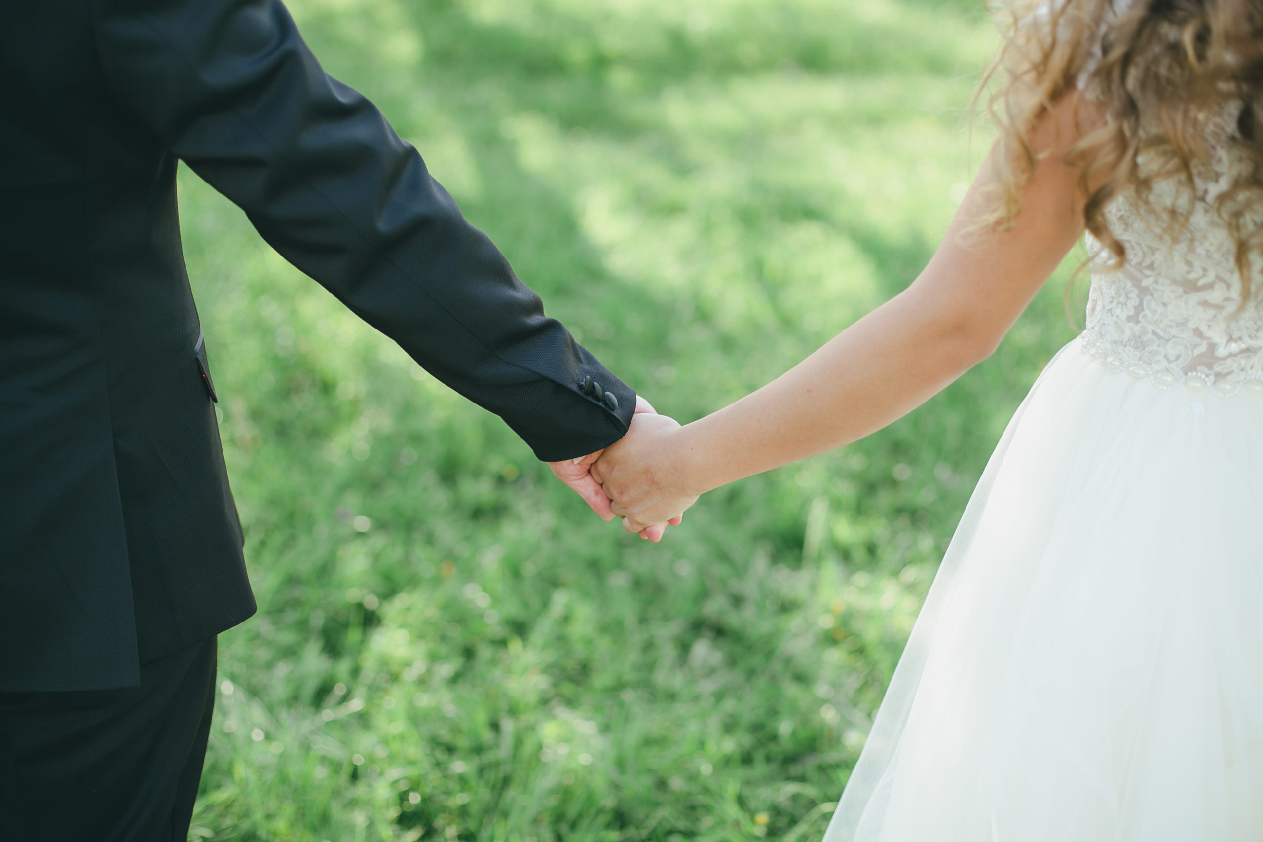 closeup-bride-groom-holding-hands-isolated-1715835700