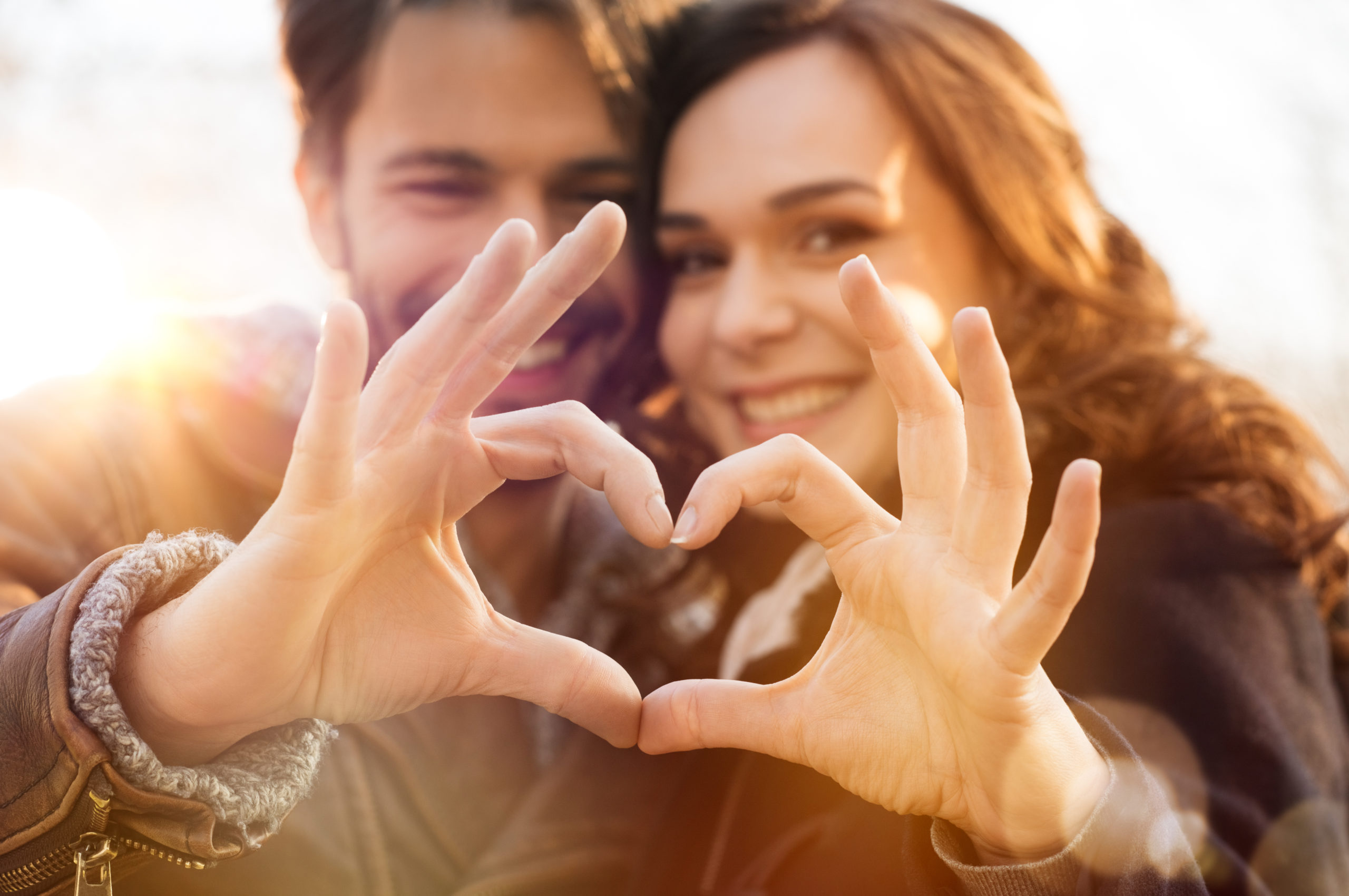 Closeup,Of,Couple,Making,Heart,Shape,With,Hands