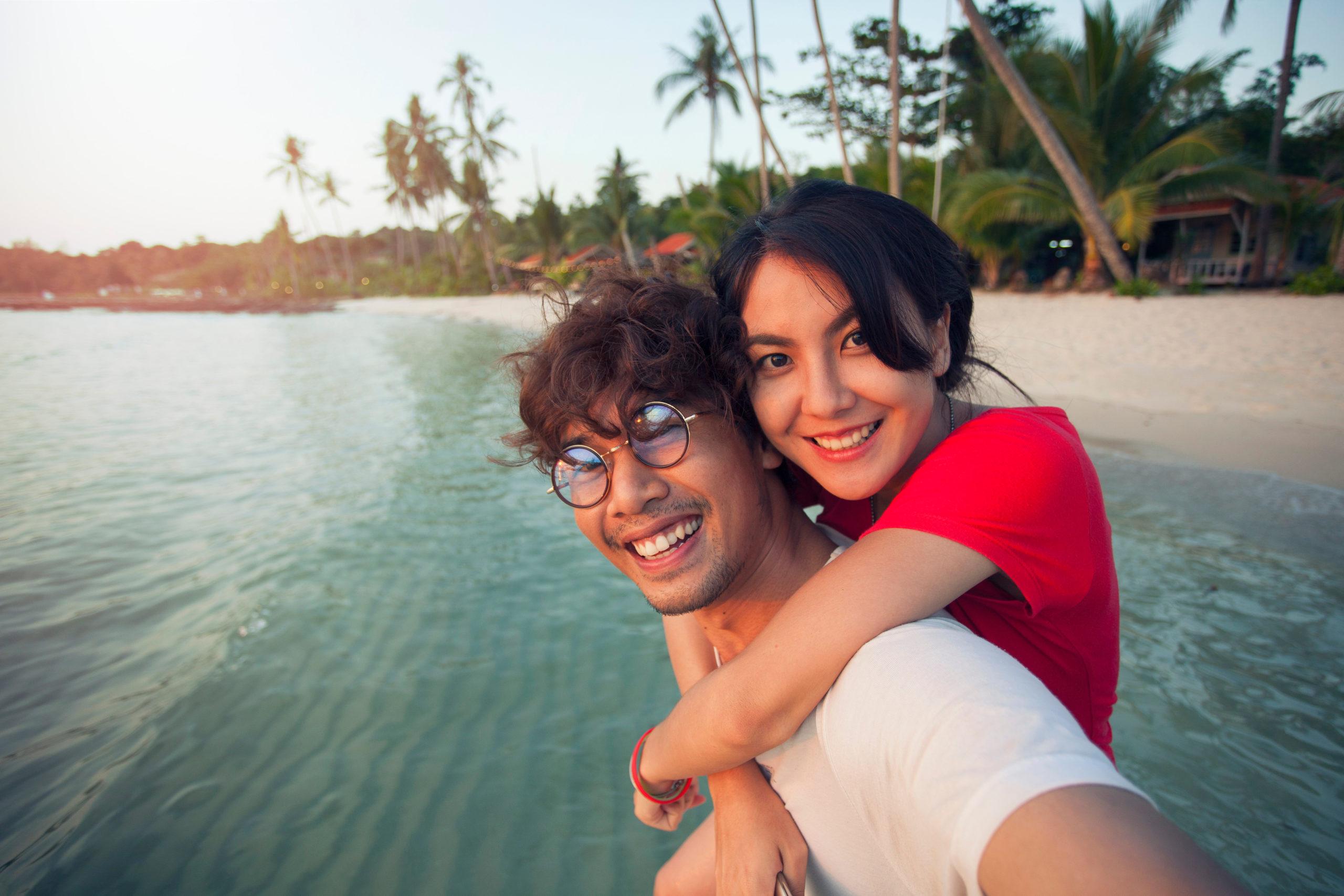 couple-traveler-asian-selfie-on-beach-1220653387