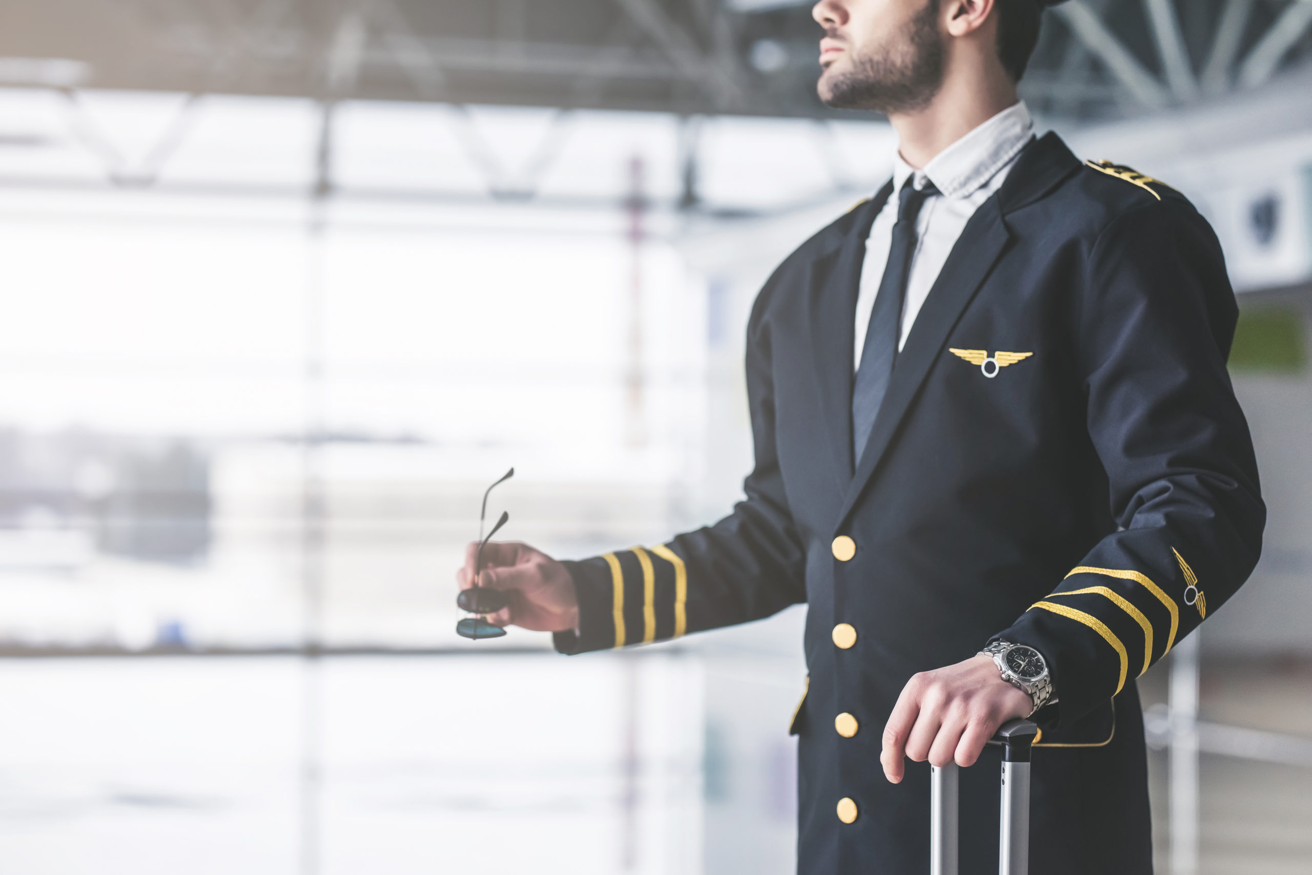 cropped-image-handsome-young-male-pilot-1034070187