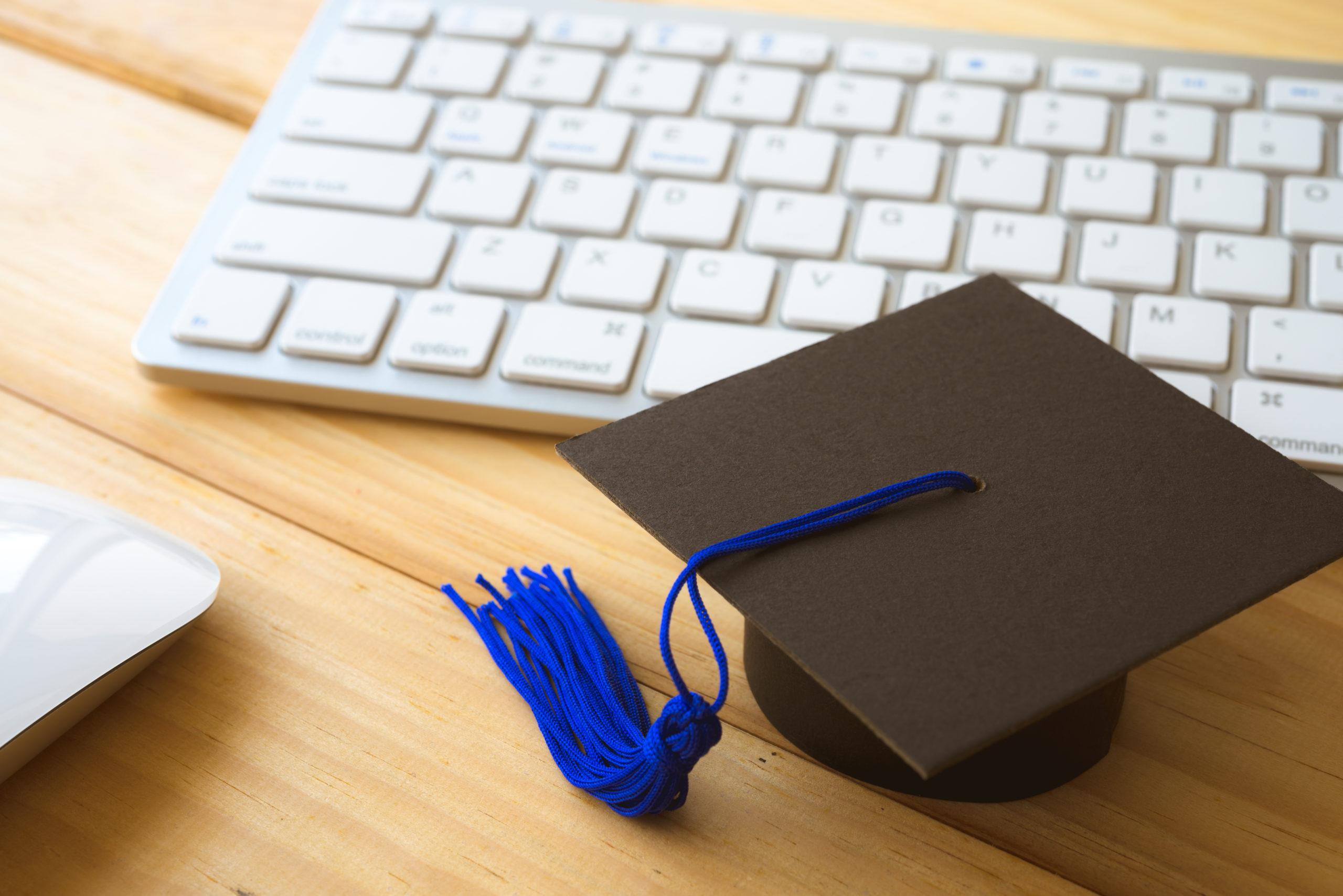graducate-cap-on-keyboard-mouse-elearning-1051986260