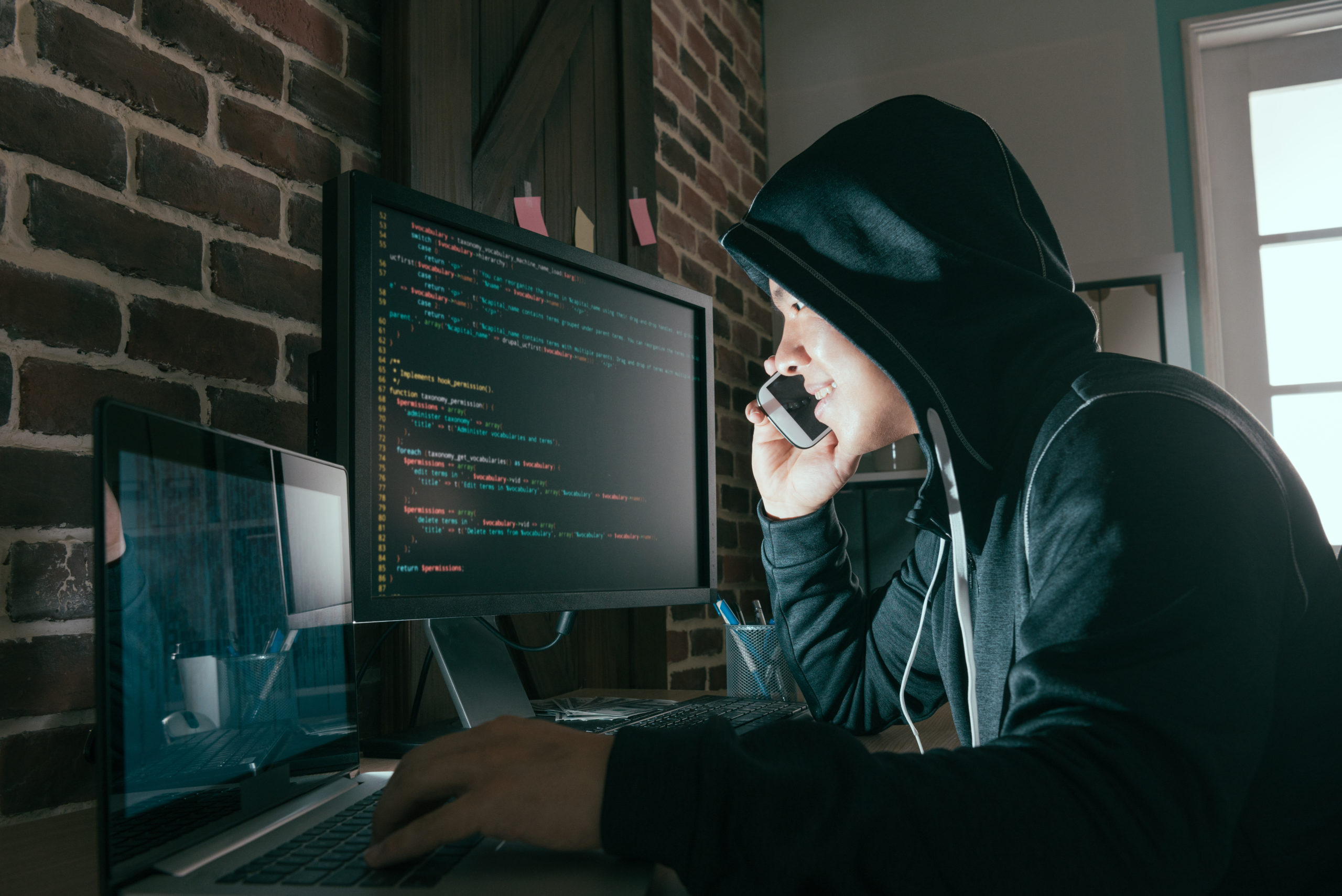 hacker-using-mobile-smartphone-calling-victim-660055192