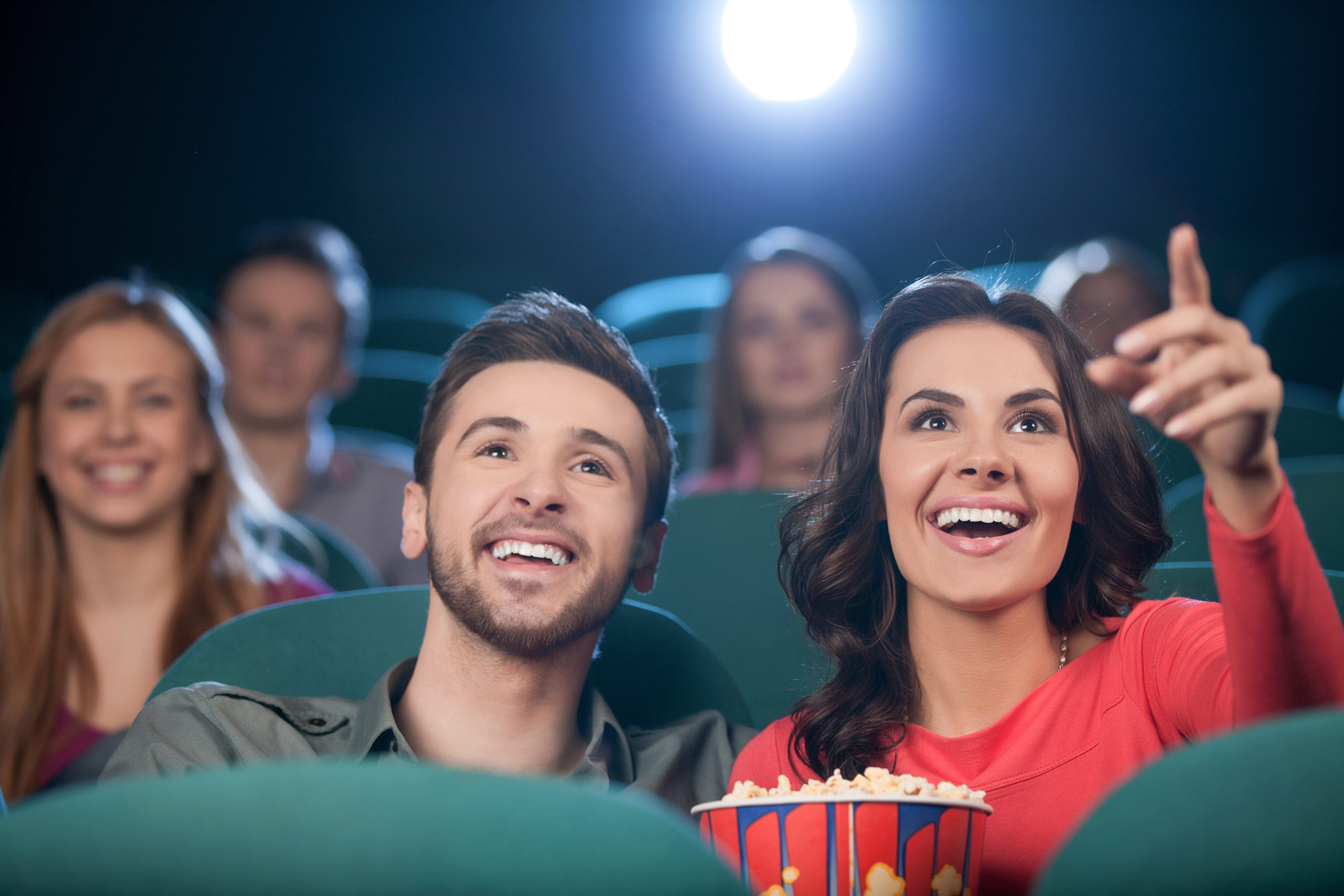 Happy,Couple,At,The,Cinema.,Cheerful,Young,Couple,Watching,Movie