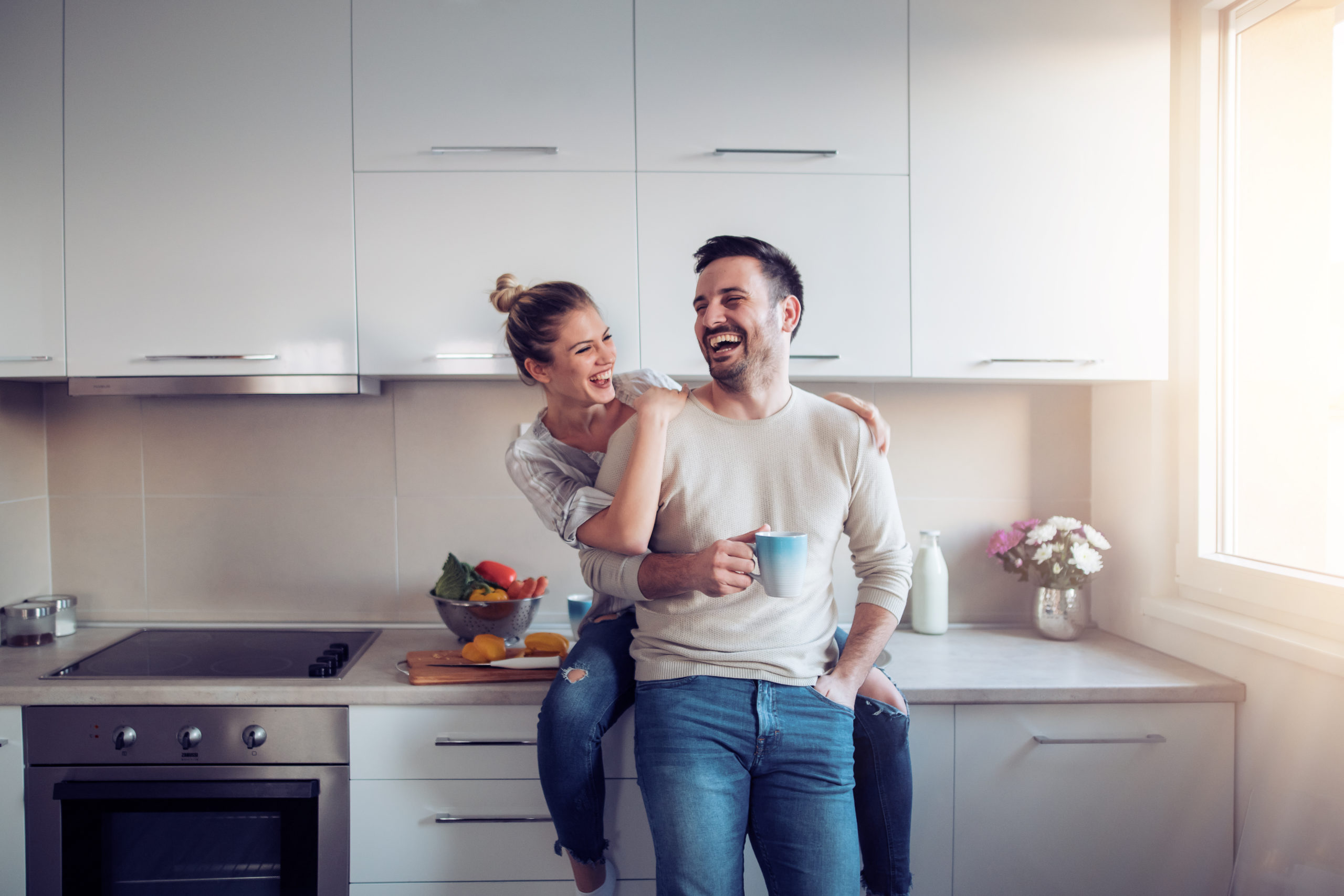 Romantic,Young,Couple,Cooking,Together,In,The,Kitchen,having,A,Great