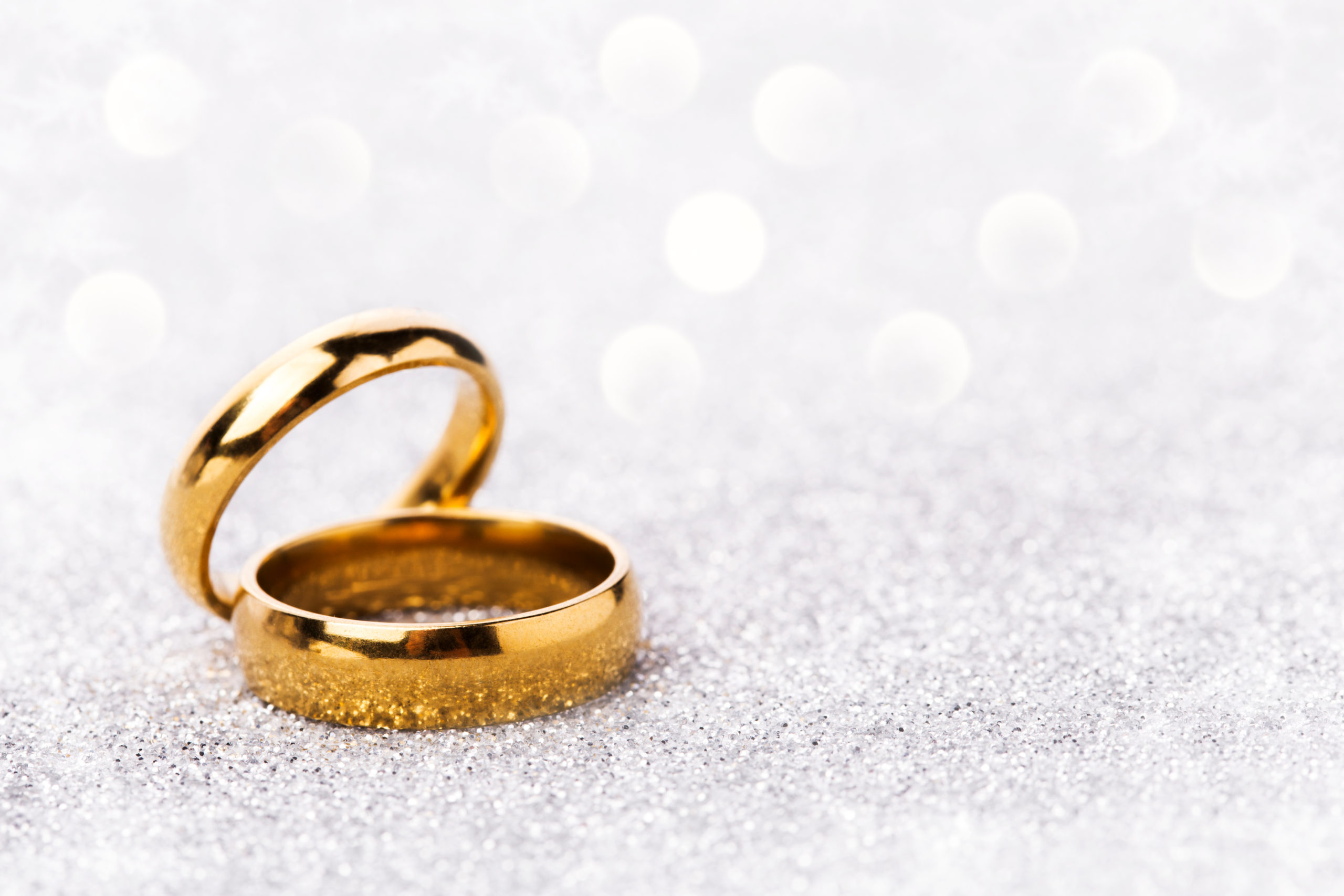 Wedding,Ring,Celebration,Background,With,Two,Gold,Rings