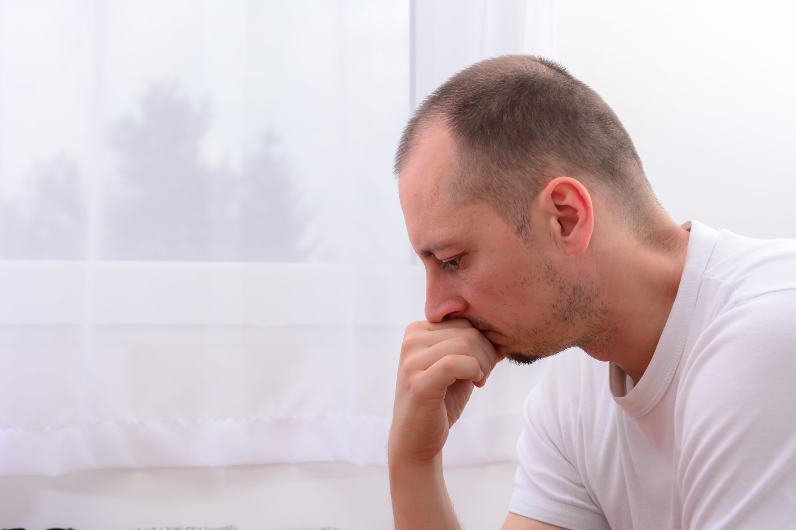 Lonely,Depressed,Man,Near,Window,At,Home.,Unhappy,Male,Isolated