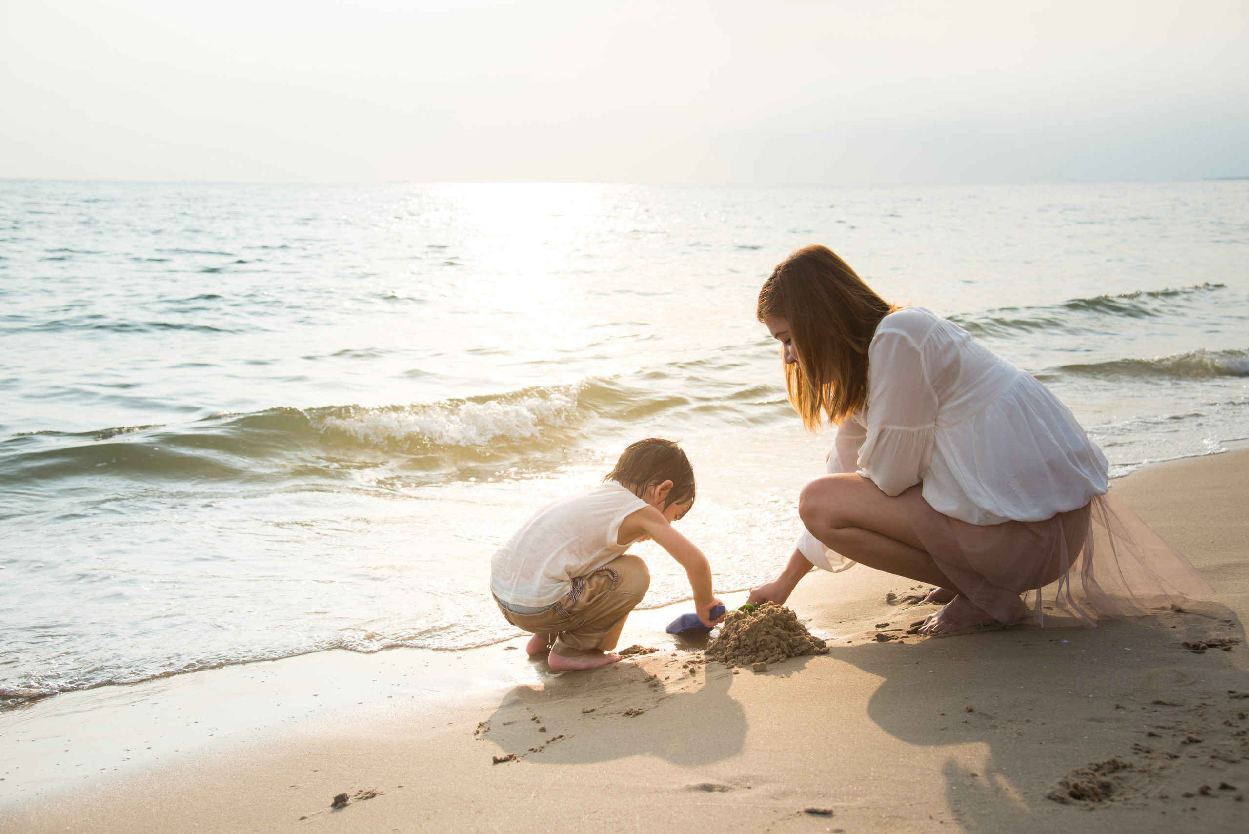 mother-son-playing-on-beachvintage-filter-329433899