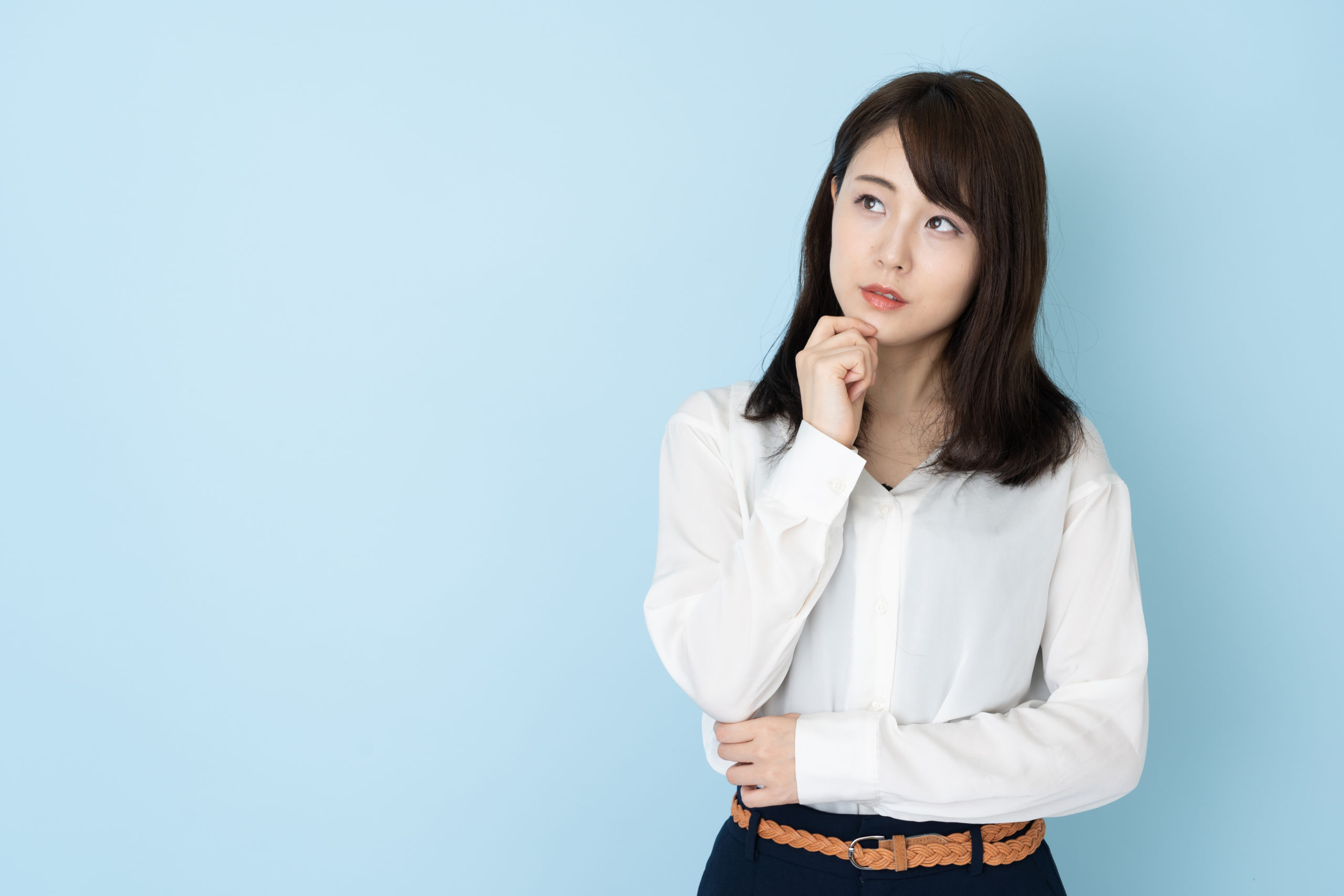 portrait-attractive-asian-woman-on-blue-1194616651