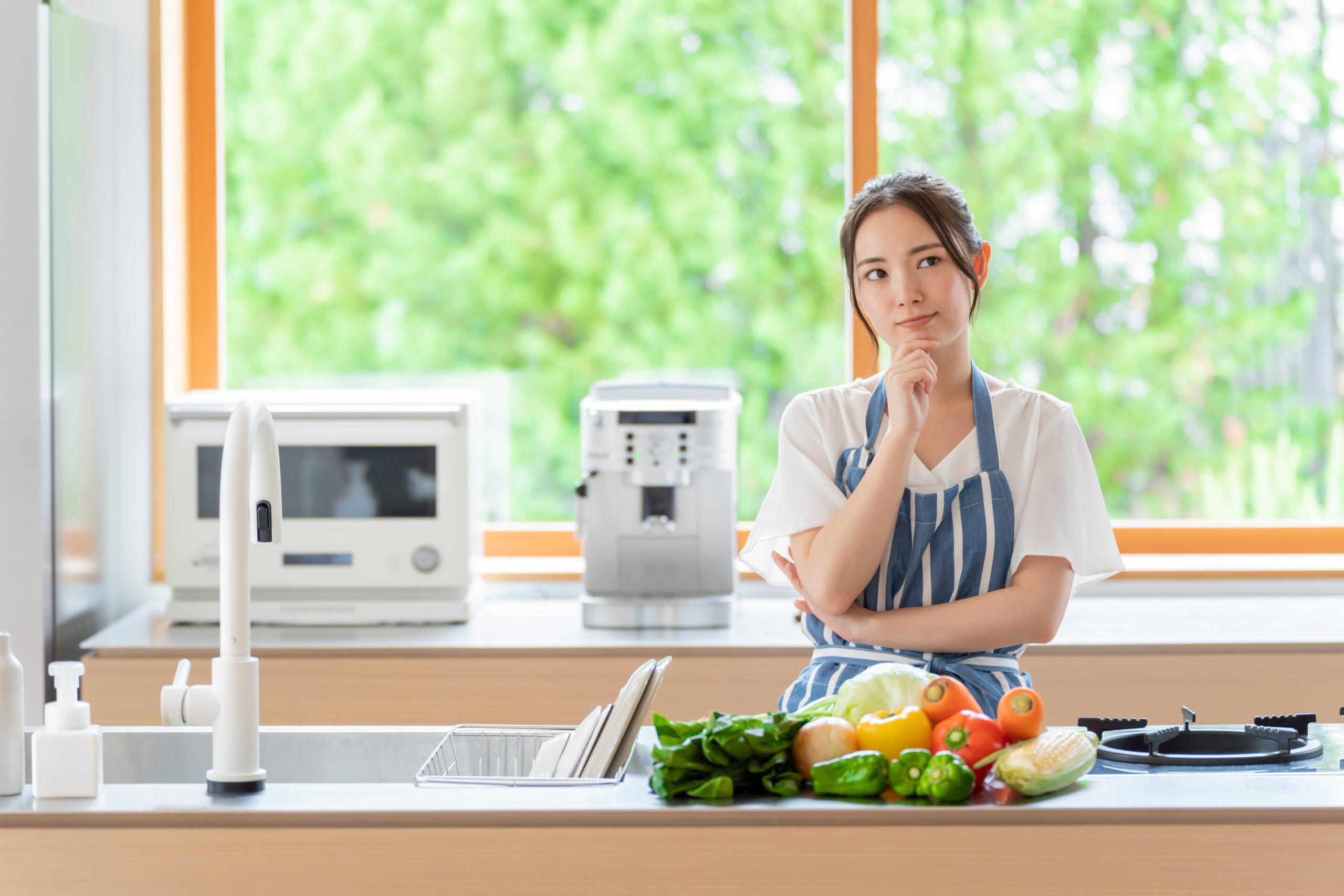 portrait-attractive-asian-woman-thinking-kitchen-1812709528