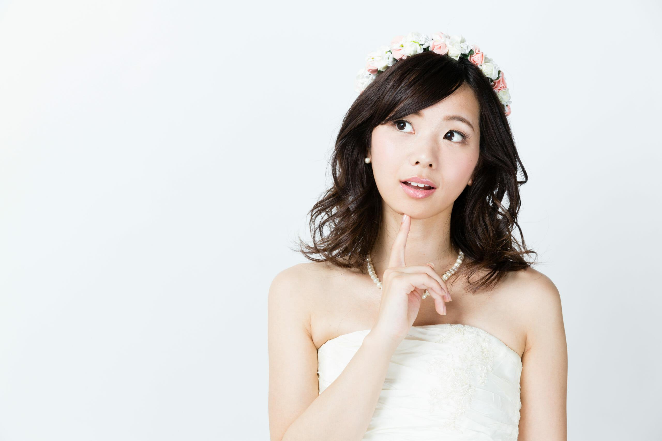 portrait-attractive-asian-woman-wearing-wedding-496421779