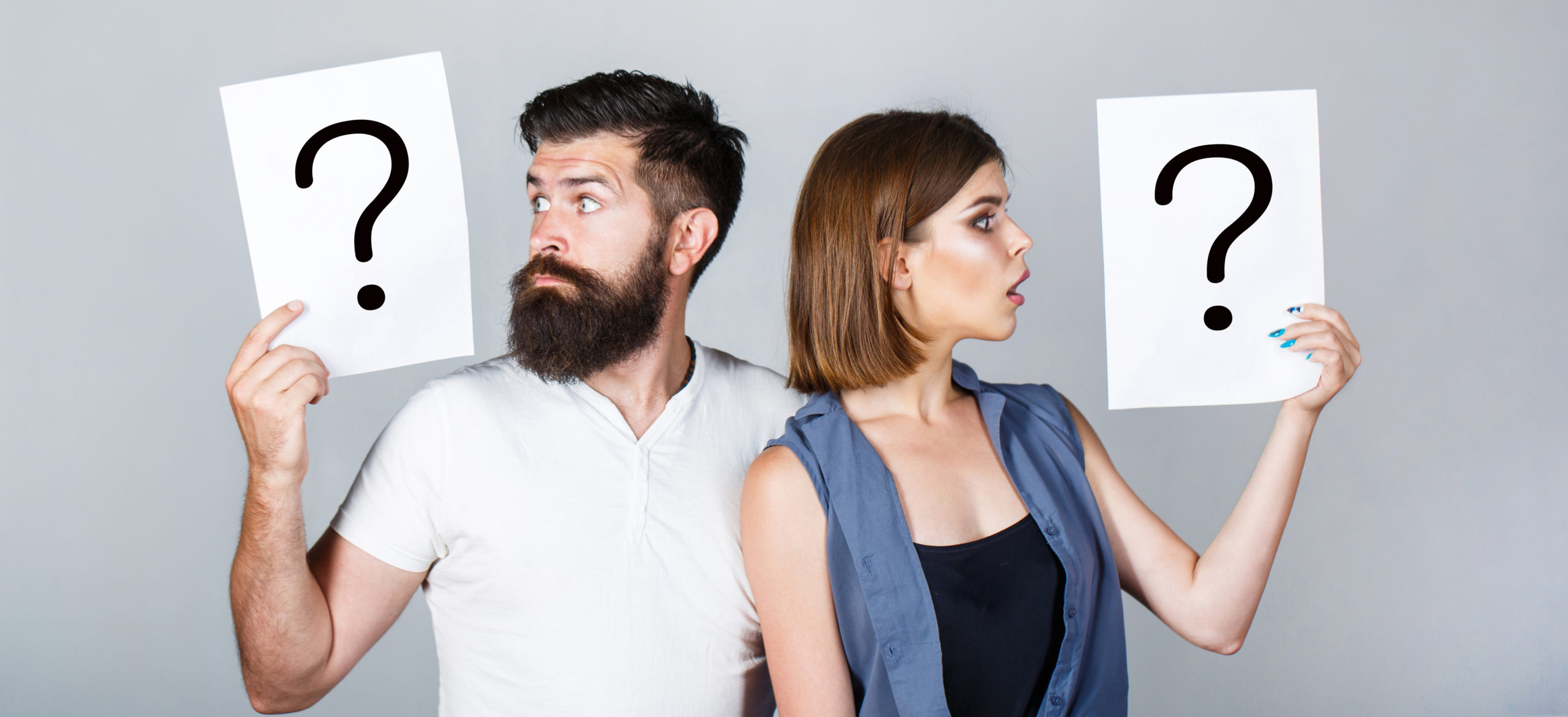 portrait-couple-holding-paper-question-mark-1208420935