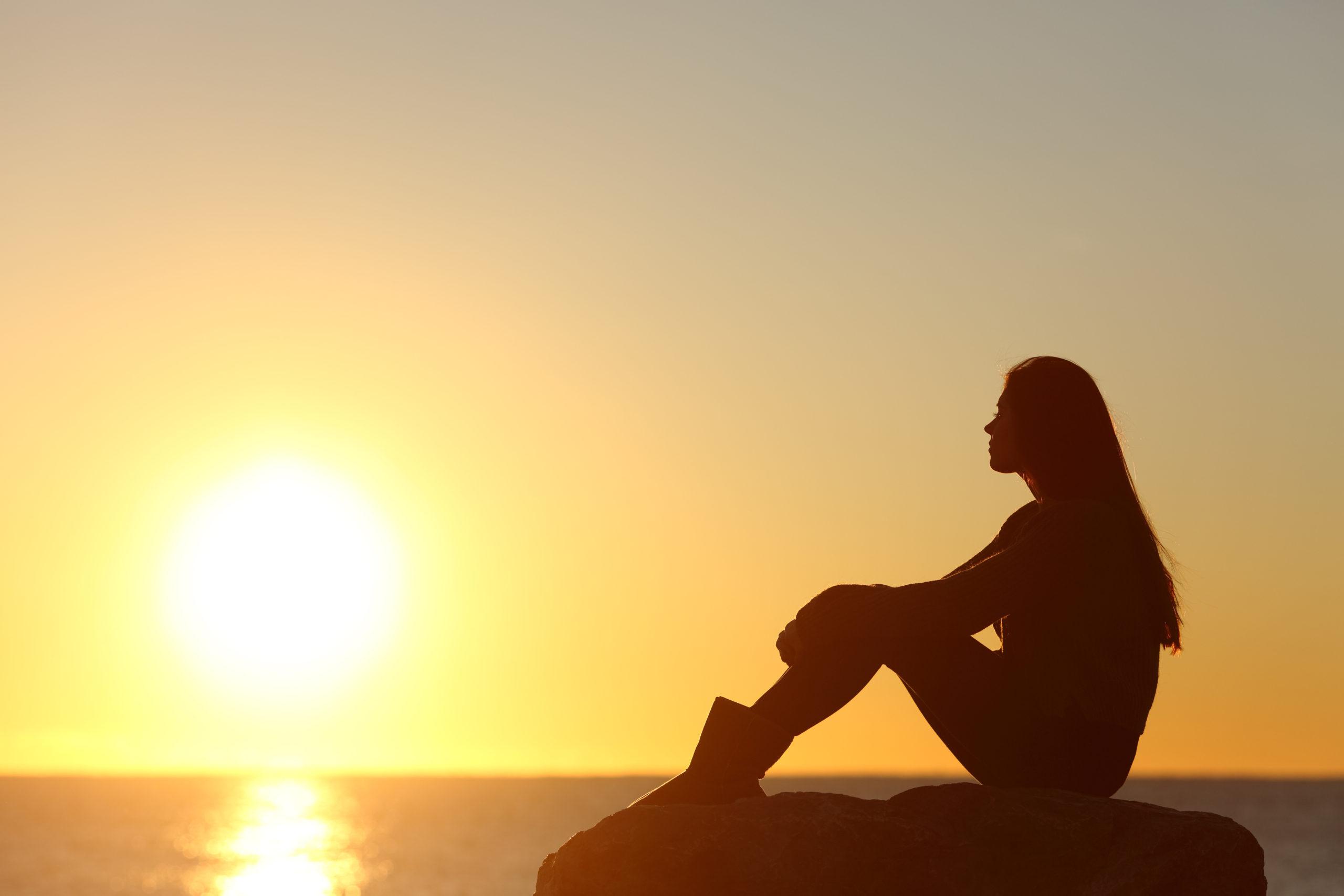 profile-woman-silhouette-watching-sun-on-249461866