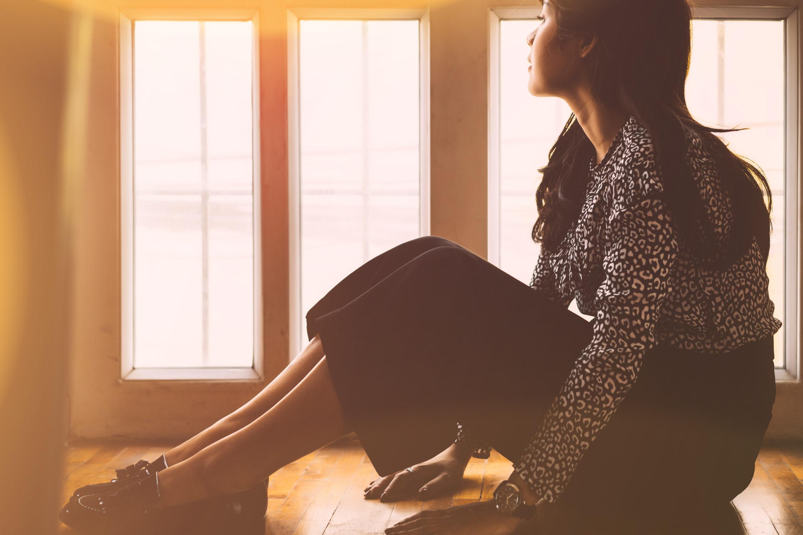 sad-depressed-woman-sitting-on-floor-1316954081