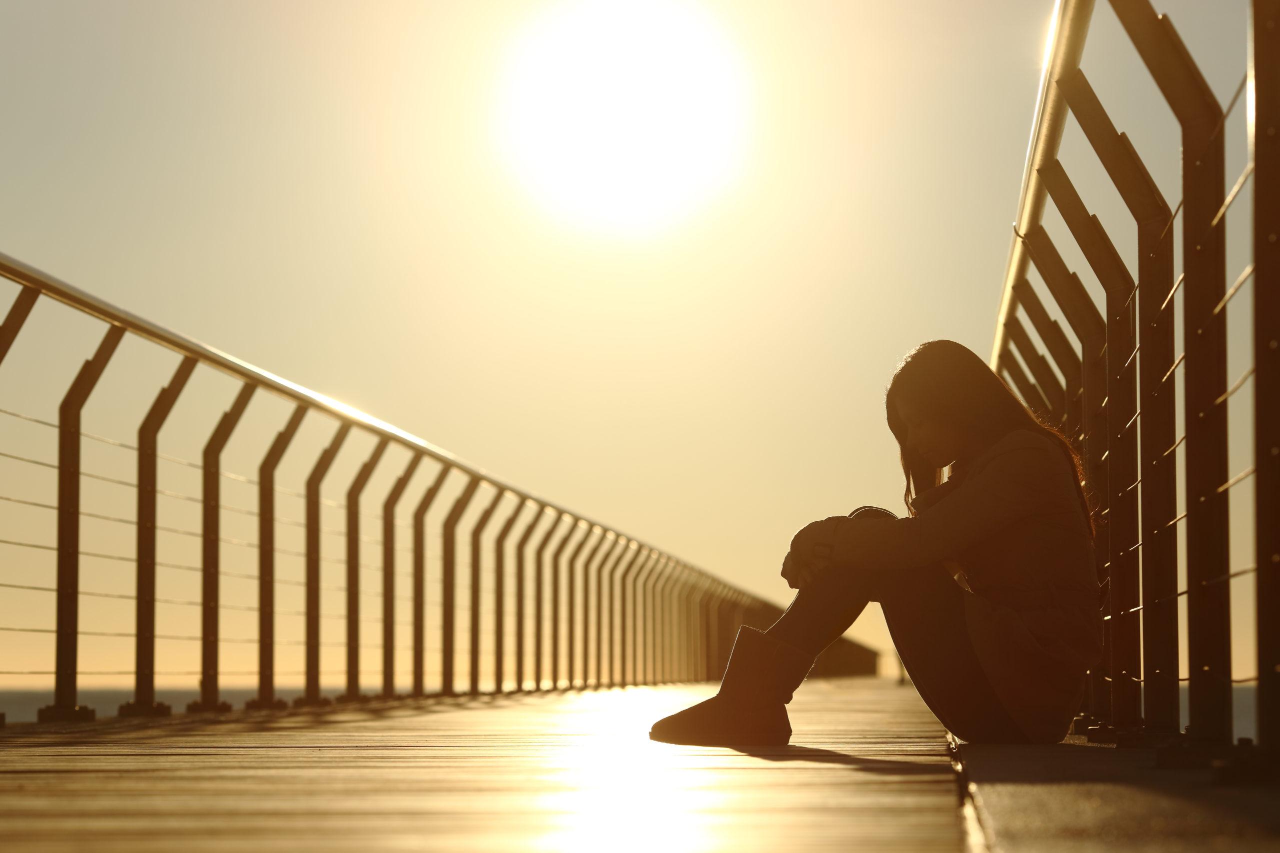 sad-teenager-girl-depressed-sitting-floor-250744180