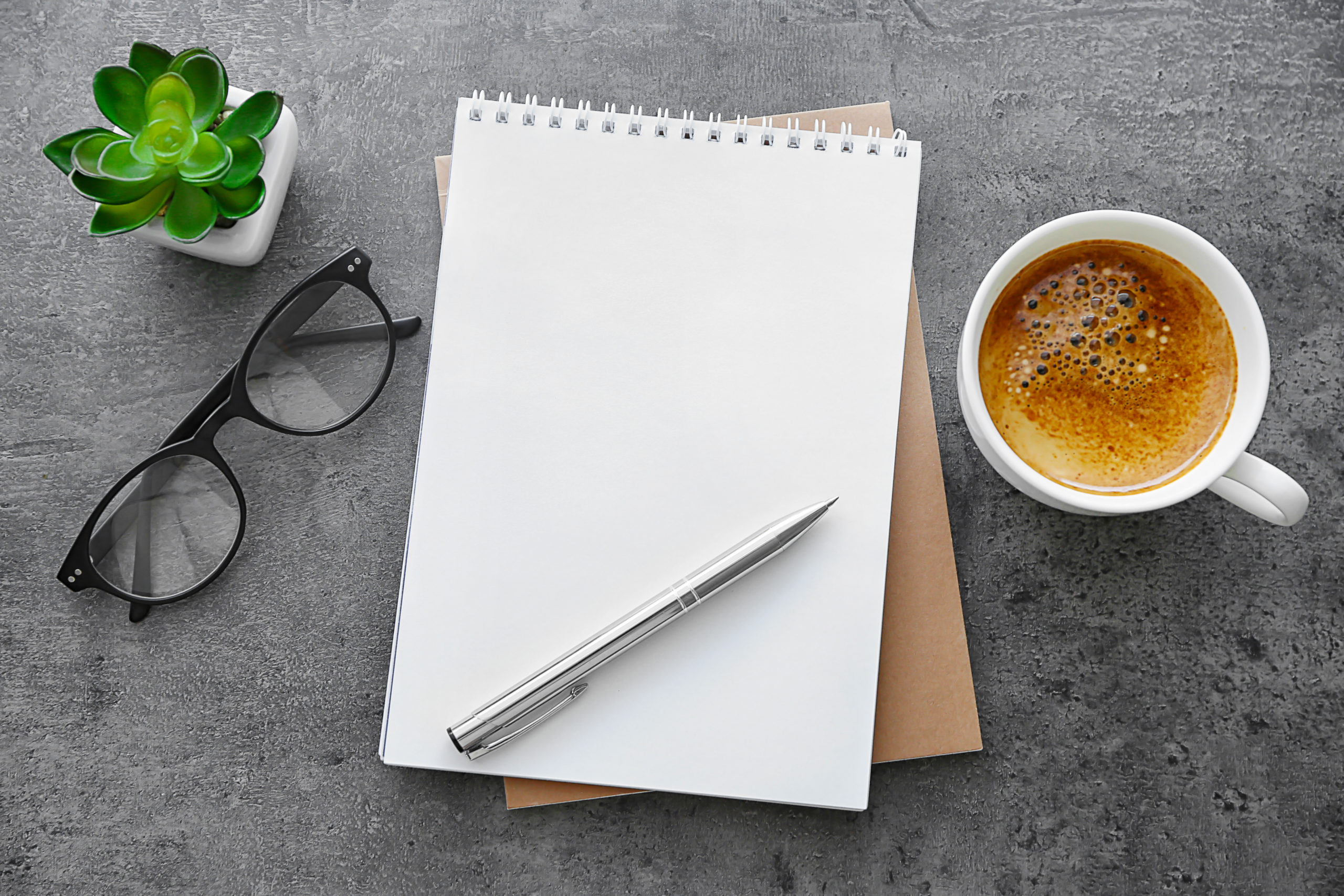School,Notebook,With,Glasses,And,Coffee,On,Table