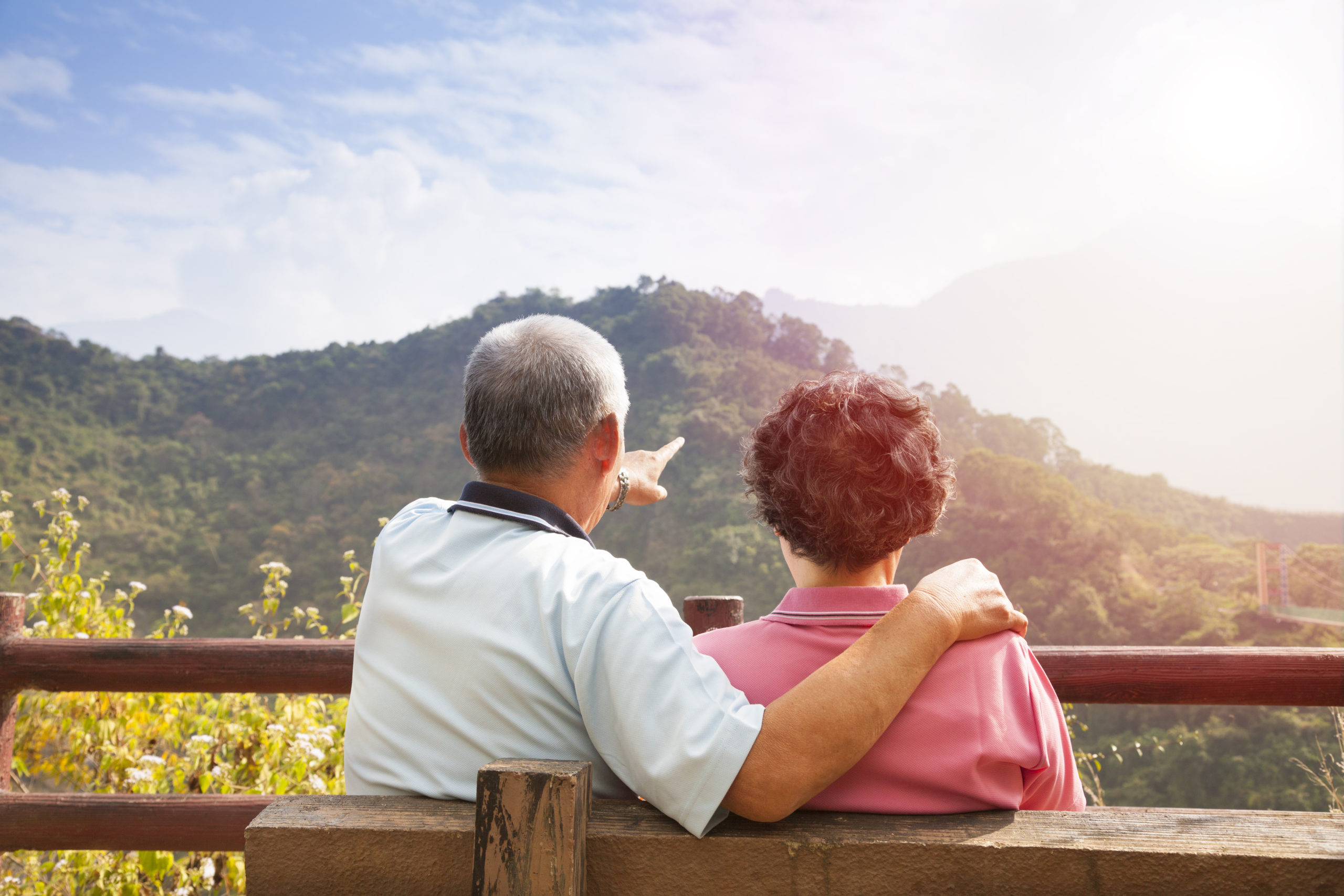 Senior,Couple,Sitting,On,The,Bench,Looking,The,Nature,View