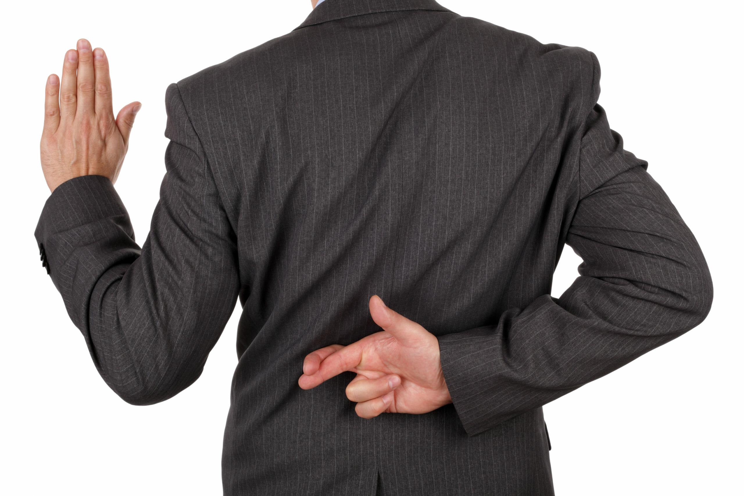 swearing-oath-fingers-crossed-behind-back-118623196