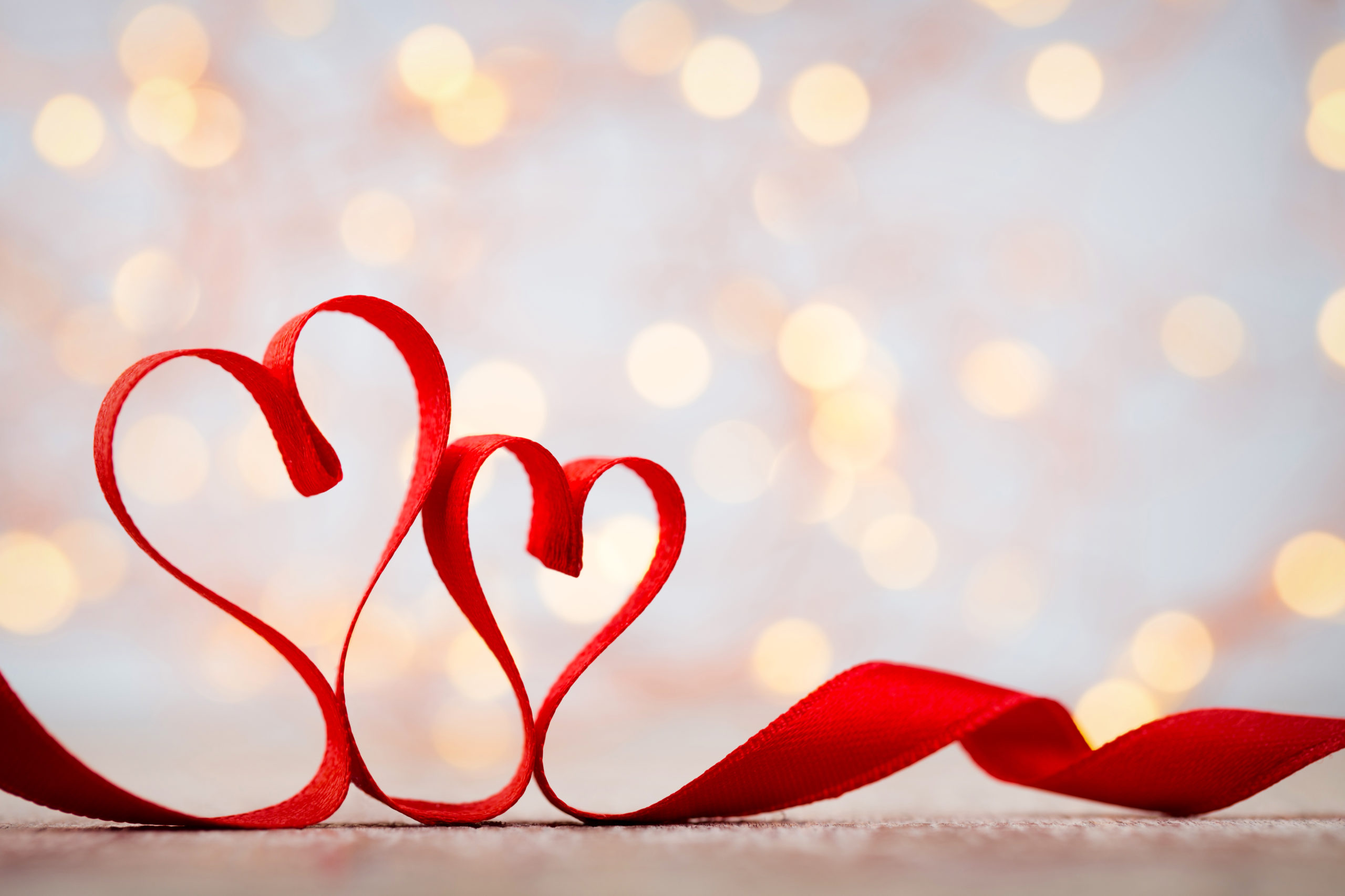two-red-hearts-ribbon-valentines-day-570268582