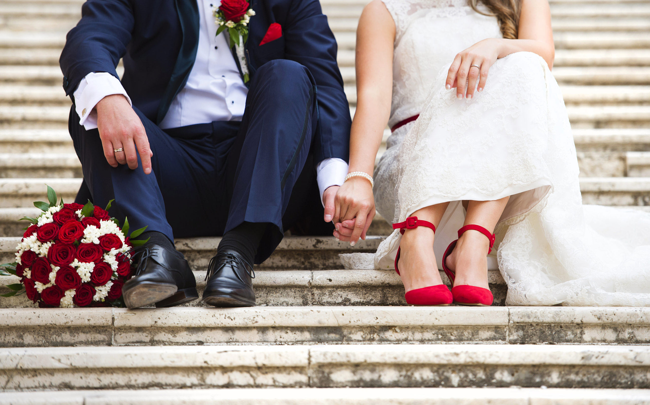 unrecognizable-young-wedding-couple-holding-hands-265157513