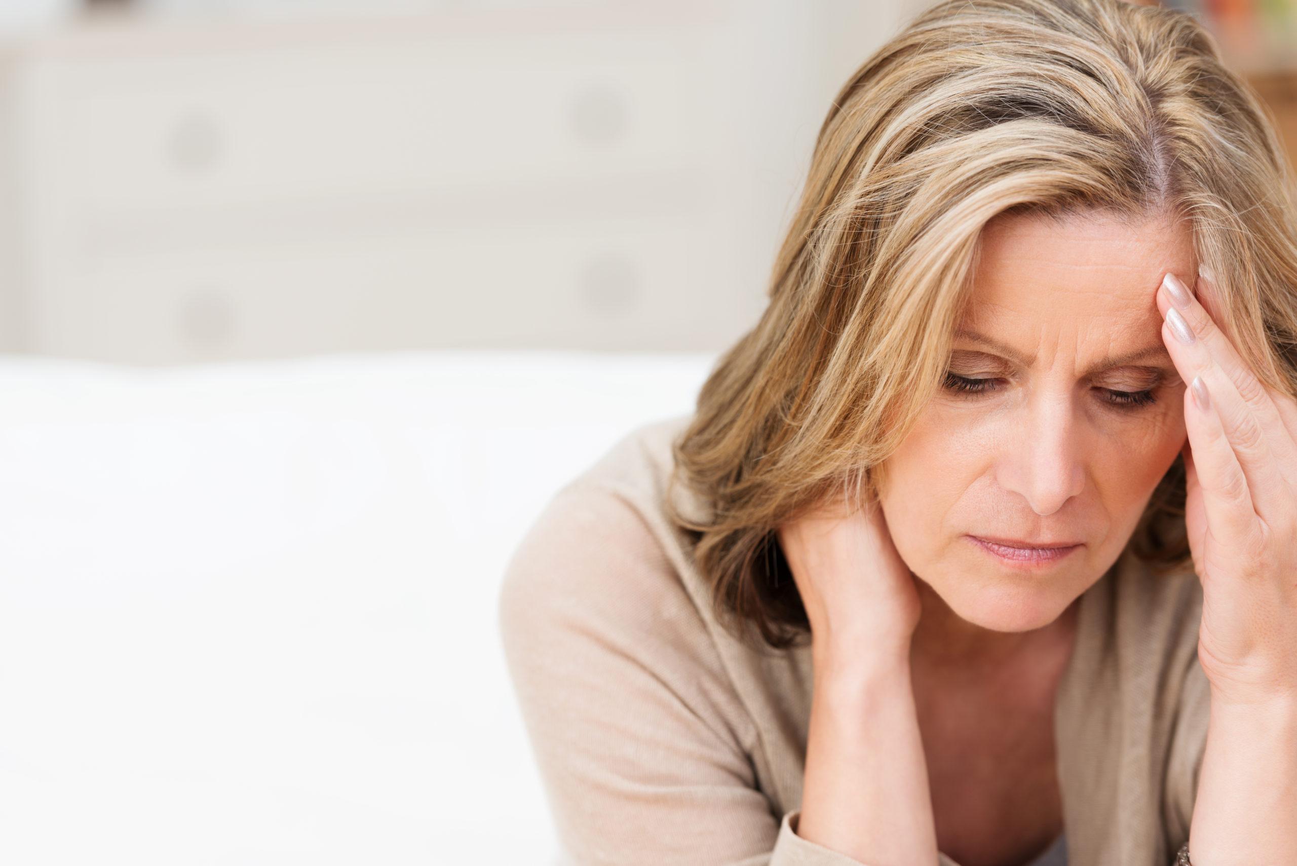 woman-suffering-stress-headache-grimacing-pain-192268697