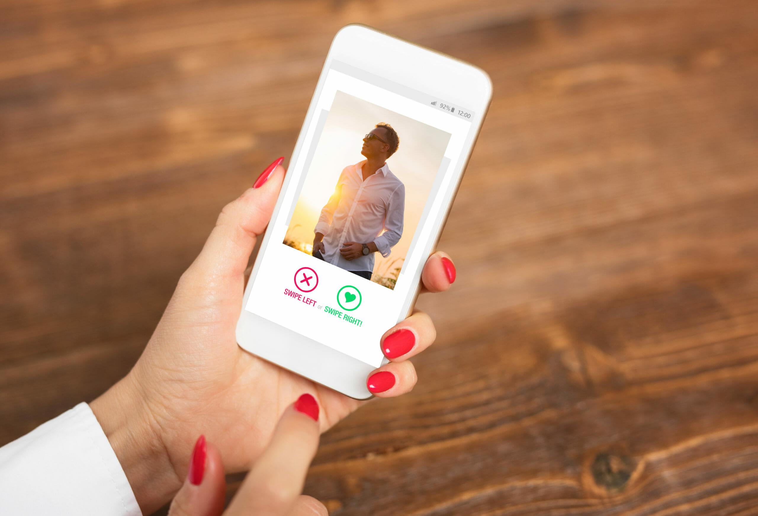woman-using-dating-app-swiping-user_1067926880