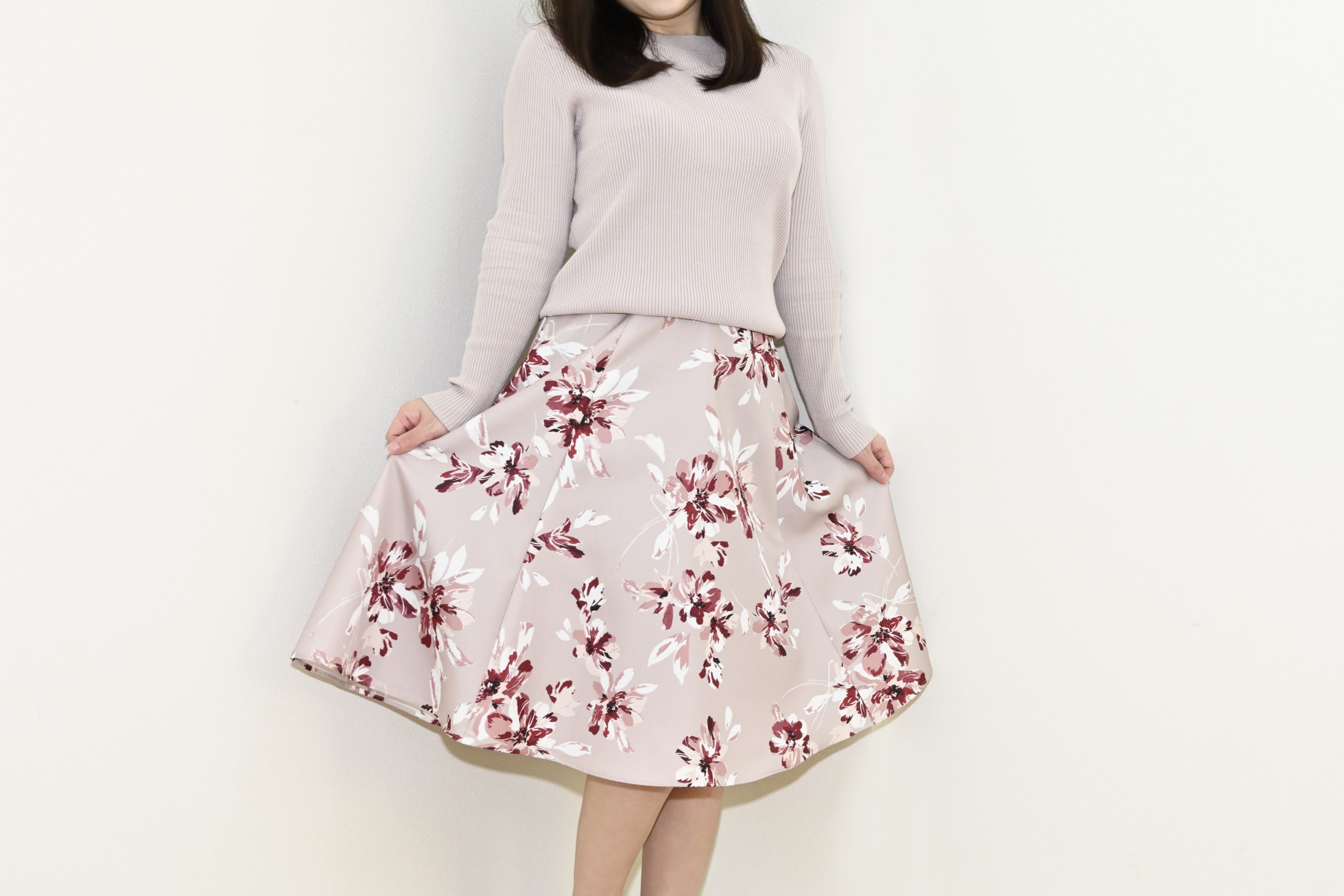 Women,In,Knitted,Shirts,And,Floral,Skirts