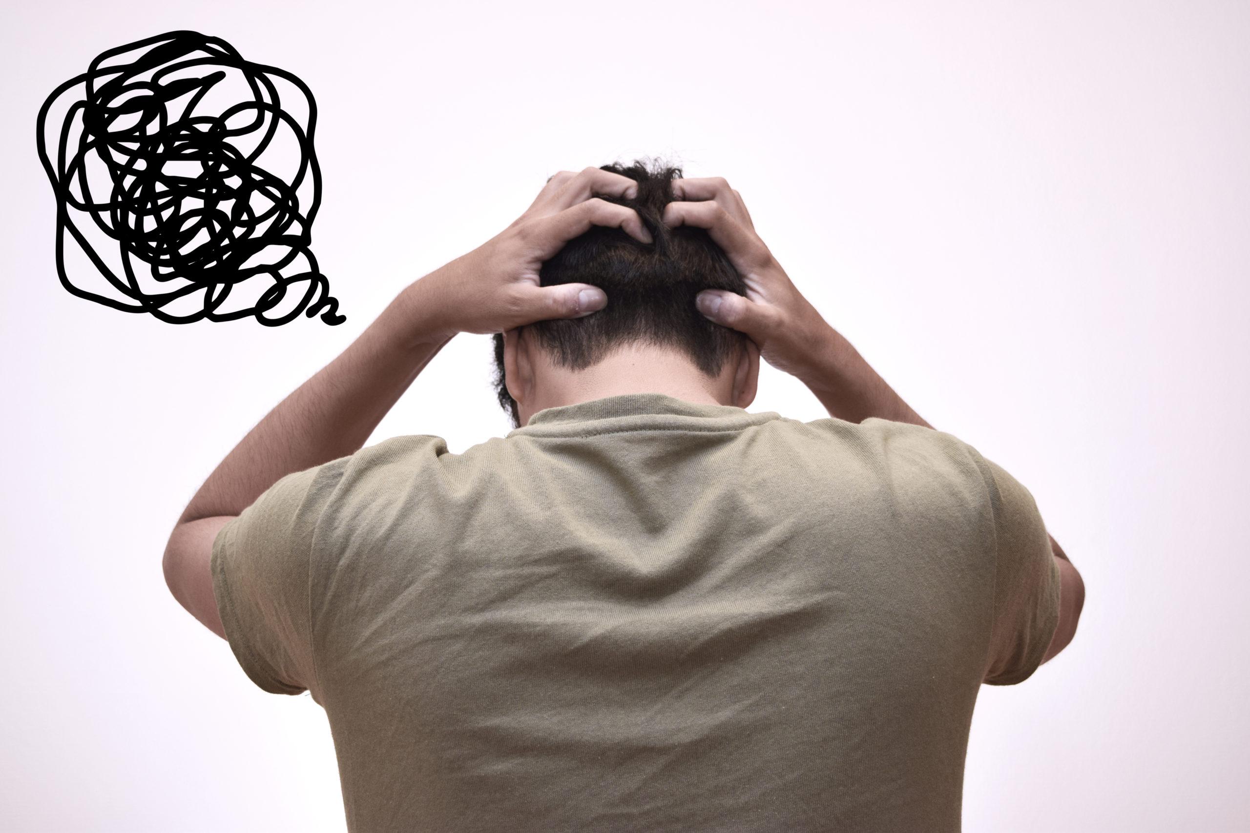 worried-man-touching-his-head-mental-516445780