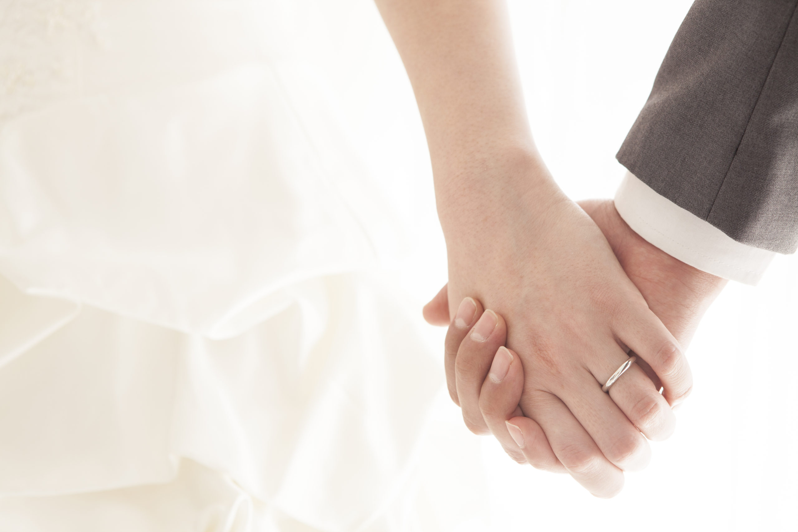 young-married-couple-holding-hands-ceremony-265528205