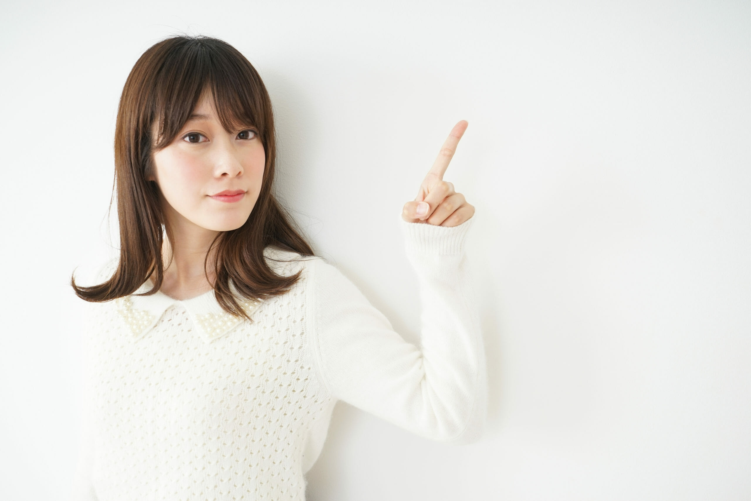 young-woman-pointing-something-smile-615350024